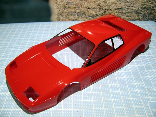 rosso_ferrari_24_512tr_painted_body_front.jpg